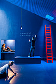 Artistic scene: three people in blue room with red ladder