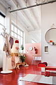 Entrance area with red floor in loft apartment with high ceiling
