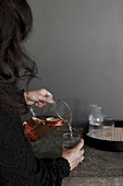 Woman pouring herself a glass of mulled wine