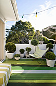 Roof terrace with board floor painted in various shades of green