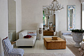 Modern furniture and antique decorative elements in exclusive living room
