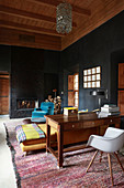 Black walls and wooden ceiling in Oriental-style living room