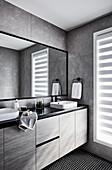 Washstand in elegant bathroom with grey wall tiles