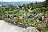 Raised permaculture beds in idyllic cottage garden
