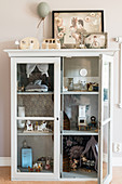DIY dolls' house in old display case