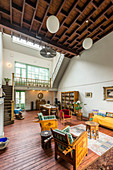 Large, open-plan, double-height interior with gallery