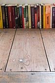 Row of books on board floor