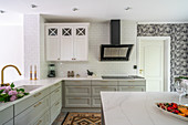 Bright fitted kitchen with L-shaped counter