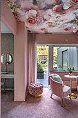 Girl's bedroom decorated in pink with floral wallpaper on ceiling, access to terrace and ensuite bathroom