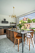 Elegant kitchen island with extended counter and bar stools