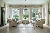 Two sofas facing one another in living room in shades of cream