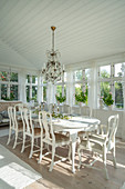 Dining room in antique Swedish style with conservatory windows