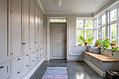 Scandinavian-style foyer with fitted cupboards