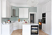 White fitted kitchen with island counter
