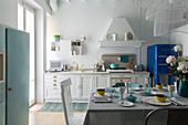 Set breakfast table in white country-house kitchen