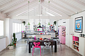 Open roof structure in bright loft apartment with hot pink and pale pink accents
