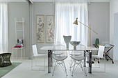 White table and classic chairs in front of window in dining area