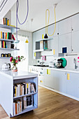 White, modern kitchen with bright colourful accents