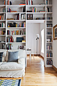 Floor-to-ceiling bookcase around doorway leading into dining room