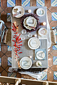 Plates decorated with letters on festively decorated table
