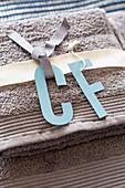Handmade paper initials for guest towels