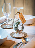 DIY place card with winter landscape under upturned wine glass