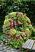 Autumn wreath with stonecrop, hydrangea, fennel, rose petals and rose hips