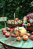 Autumn decoration with apples, walnuts, pumpkin and autumn bouquet