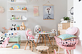 Soft toy's tea party in girl's bedroom in pastel shades