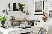 Wall-mounted lamps flanking shelf above desk and Bohemian-style accessories
