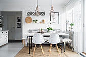 Shell chairs at table in Scandinavian-style dining room