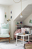 Vintage-style living room with sofa below sloping ceiling