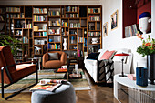 Living room in eclectic style with large bookcase along one wall