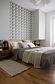 Wallpaper with graphic pattern in bedroom in natural shades