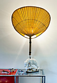 Yellow fan lamp with ceramic polar bear as base