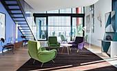Seating area in spacious, elegant interior of penthouse apartment