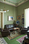 Leather sofa set and antique gramophone in seating area in music room