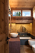 Small wooden bathroom in modern chalet