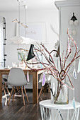 Branches of Japanese fantail willow decorated with handmade feather decorations