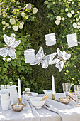 Handmade, lace butterfly decorations above table
