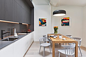 Dining area and fitted kitchen in bright, open-plan interior