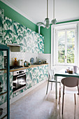 Kitchen revamped with jungle motif and green walls