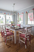 Set table in rustic dining room with blue and red accents