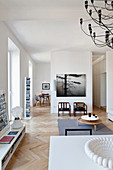 Modern open-plan interior with herringbone parquet floor