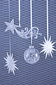 Glass Christmas decorations against blue background