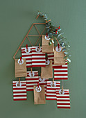 Advent calendar made from red-and-white striped and brown paper bags