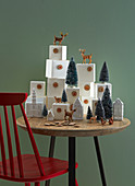 Advent calendar made from numbered boxes arranged with house-shaped ornaments