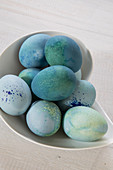 Eggs dyed blue in china bowl