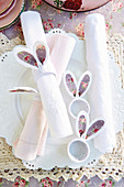 Napkin rings with floral bunny ears on set table