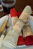 Napkin rings handmade from old book pages as table decoration
